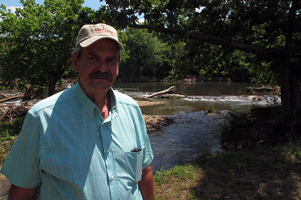 Oklahoma Conservation Commission Executive Director Trey Lam stands on the bank of the Blue River in south-central Oklahoma.  He said budget cuts will result in more staff reductions at the agency.