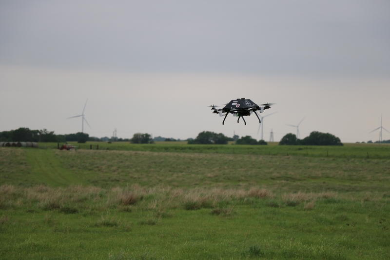 Researchers fly a copter drone near Enid, Oklahoma on May 16, 2017