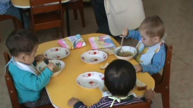 Children eat a meal at an orphanage.