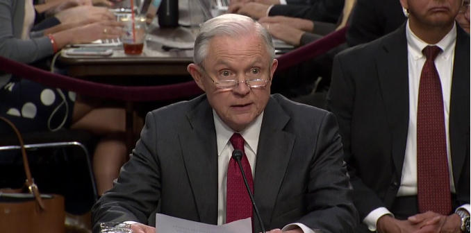 Attorney General Jeff Sessions reads his opening statement at a public hearing of the Senate Select Committee on Intelligence, June 13, 2017.