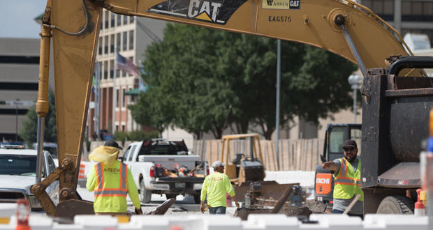 Workers on a road construction project on E.K. Gaylord Boulevard in downtown Oklahoma City.