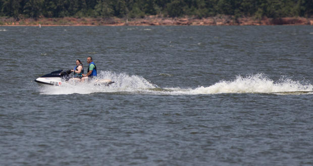 A couple rides a water scooter on Lake Thunderbird east of Norman.