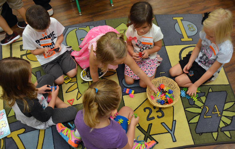Pre-K students in Broken Arrow Public Schools work on an activity in the classroom. The school district is one of several that is increasing the maximum number of pre-K students per class sizes above 20 students.
