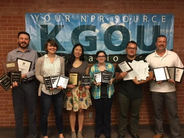 L-R: Jacob McCleland, Claire Donnelly, Nomin Ujiyediin, Paige Willett, StateImpact Oklahoma Reporter Joe Wertz, Jim Johnson hold KGOU awards
