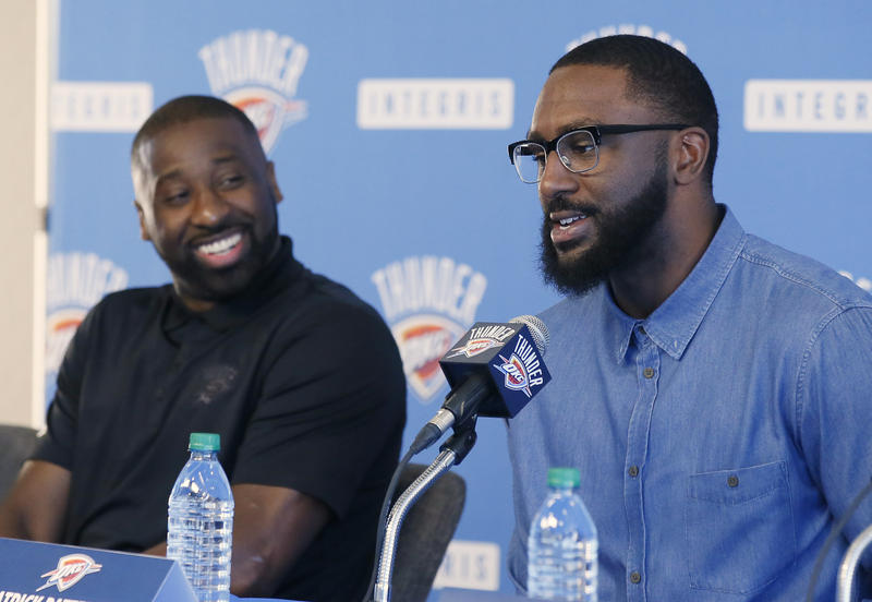 Oklahoma City Thunder guard Raymond Felton, left, smiles as forward Patrick Patterson, right, answers a question during a news conference to introduce the players in Oklahoma City, Tuesday, July 11, 2017.