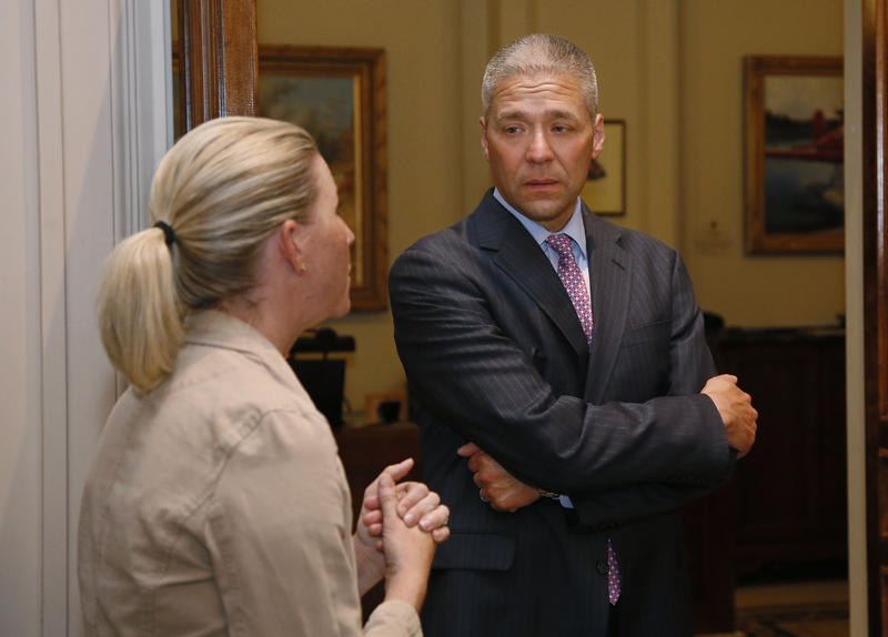 Newly-elected Oklahoma state Sen. Michael Brooks, right, talks with Sarah Taylor, left, Democratic Leadership staff, during a tour of the state Capitol in Oklahoma City, Wednesday, July 12, 2017. Brooks won his Senate seat in a special election Tuesday, J