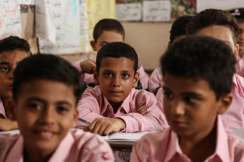 School children attend the first day of classes at the Talaat Harb government primary school, in the popular district of Shubra, Cairo, Egypt, Monday Sept. 28, 2015.