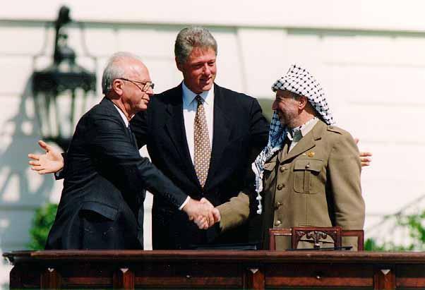 Israeli Prime Minister Yitzhak Rabin, U.S. President Bill Clinton, and Yasser Arafat at the Oslo Accords signing ceremony on September 13, 1993.