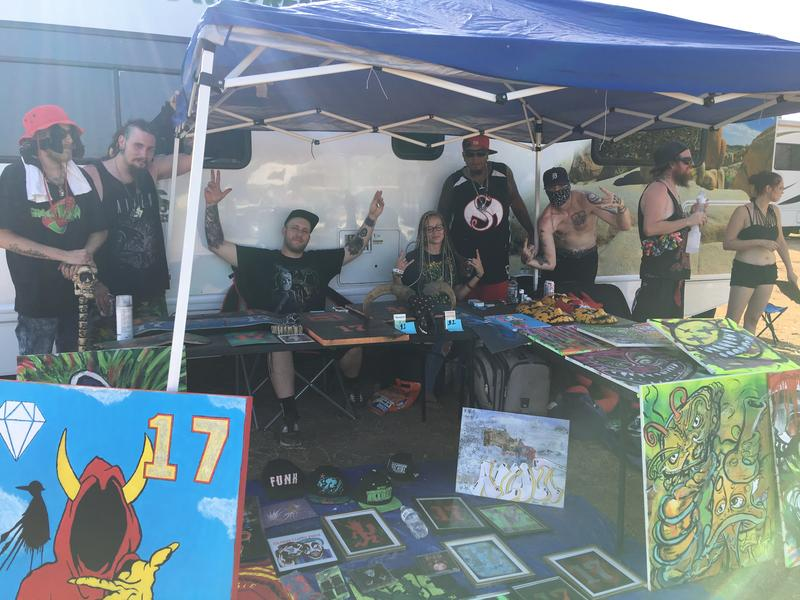 Juggalos from Fredericksburg, VA sell Insane Clown Posse merchandise outside their RV