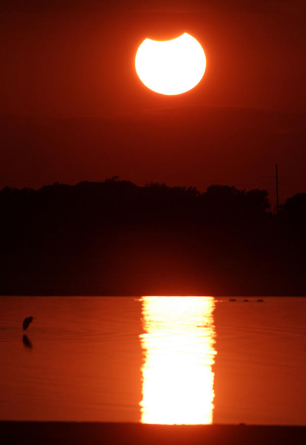 A partial solar eclipse captured over Lake Hefner in Oklahoma City in 2014.