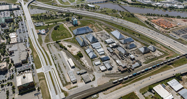 An aerial view of traffic moving along Interstate 40 past the Producers Cooperative Oil Mill in downtown Oklahoma City.