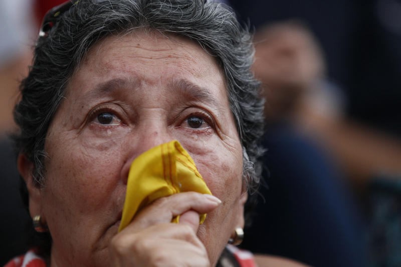 An anti-government demonstrator cries during a vigil in honor of those who have been killed during clashes between security forces and demonstrators in Caracas, Venezuela, Monday, July 31, 2017.