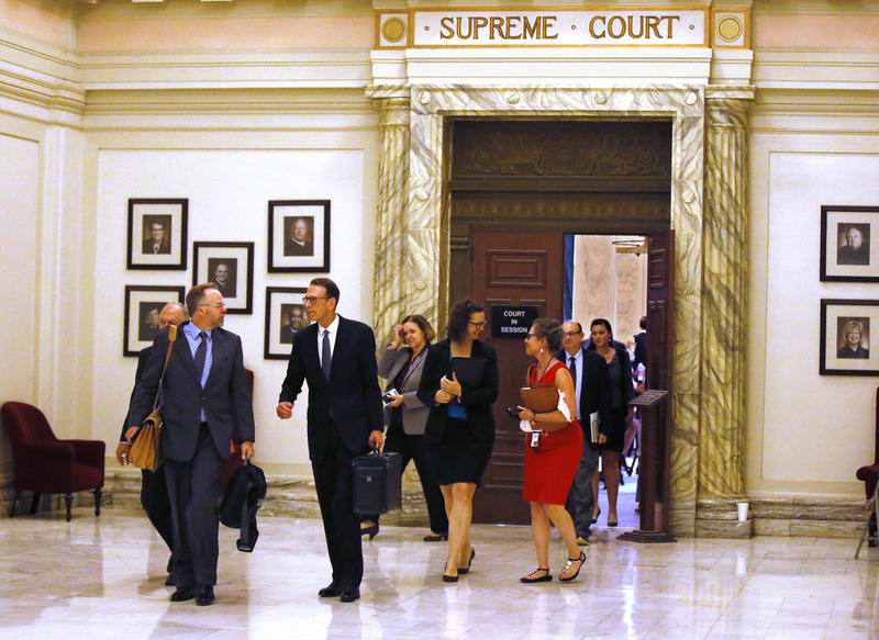 Former U.S. Attorney Robert McCampbell, second from left, who represents Phillip Morris USA Inc., R.J Reynolds Tobacco Co. and others, leaves the Oklahoma Supreme Court on August 8, 2017.