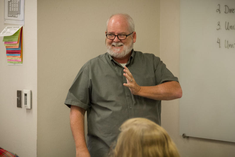Unviersity of Oklahoma Professor Gary Davissigns to his American Sign Language I class, which is part of the College of Education's special education program.
