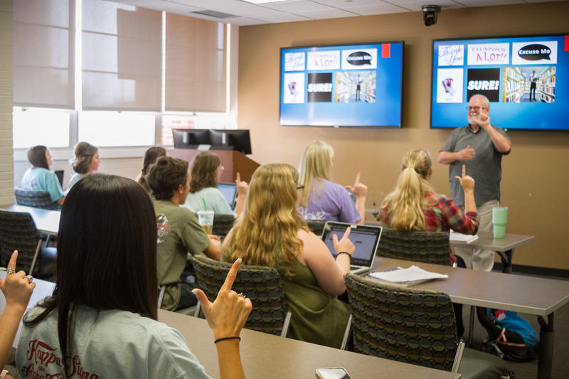 Professor Gary Davis signs to his students during a lecture in his American Sign Language class.  The class is offered through the University of Oklahoma's Department of Educational Psychology.