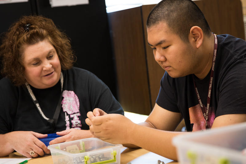 Angie Hopkins, a paraprofessional with Jenks Public Schools, works with special education student Ryan Chen.