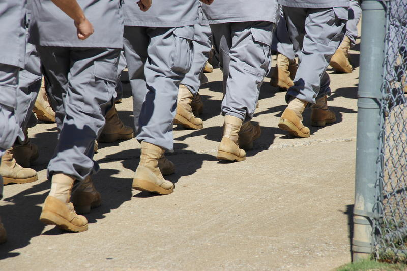 Women in the Regimented Treatment Program at the Dr. Eddie Warrior Correctional Center in northeast Oklahoma wear military-style boots and uniforms that distinguish them from other inmates.