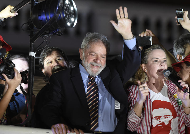 Former Brazilian President Luiz Inacio Lula da Silva greets supporters after giving his testimony to a federal judge overseeing a bribery investigation in Curitiba, in Curitiba, Brazil, Wednesday, Sept. 13, 2017.