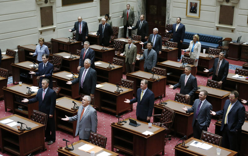 Members of the Oklahoma Senate stand and pay tribute to the Oklahoma flag at the start of a special session of the legislature in Oklahoma City, Tuesday, Sept. 3, 2013.