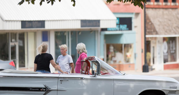 Three women chat in front of business storefronts in downtown Perry. State legislators hosted an interim study on Wednesday to evaluate what's hindering businesses from locating in rural Oklahoma.