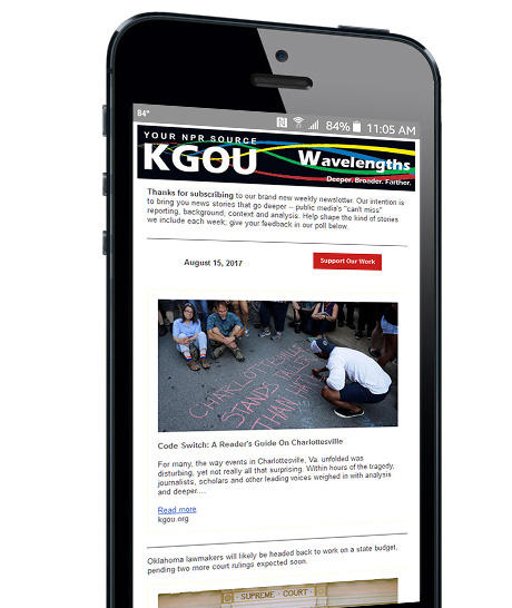iPhone with newsletter on screen