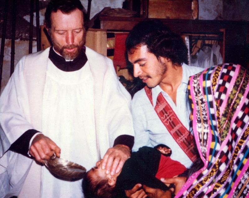 Father Stanley Rother baptizes a child in Guatemala.