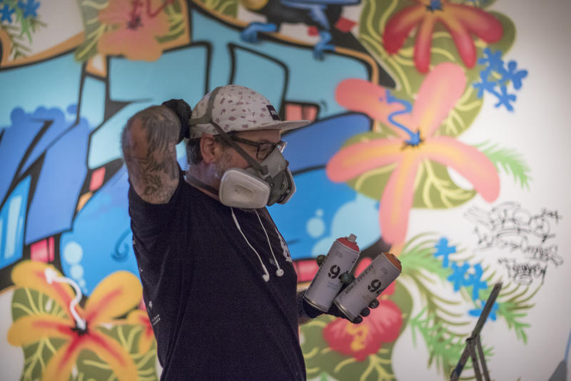 Artist Kris Kanaly installs his contribution to Not for Sale: Graffiti Culture in Oklahoma.