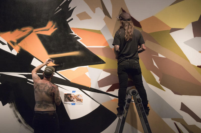 Artists work on a contribution to Not for Sale at the Oklahoma Contemporary.