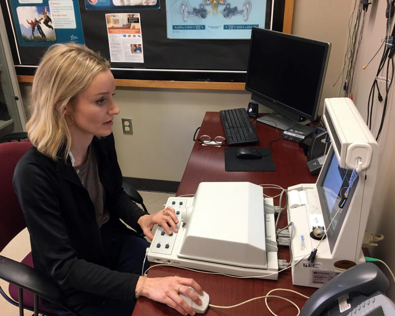 Audiologist Jillian Detwiler reviews a patient's hearing aid function at the John W. Keys Speech and Hearing Center in Oklahoma City. Detwiler oversees the Cabaret Hearing For Seniors Program, which provides high-quality hearing aids for $100 a pair.