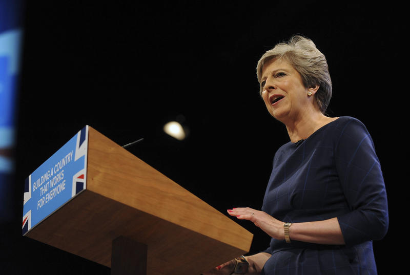 Conservative Party Leader and Prime Minister, Theresa May, addresses delegates during a speech at the Conservative Party Conference at Manchester Central, in Manchester, England, Wednesday, Oct. 4, 2017.