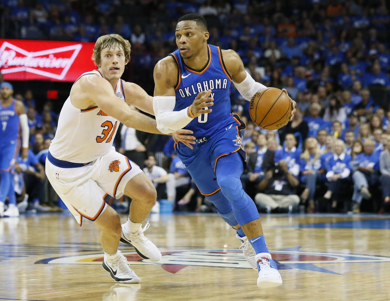 Oklahoma City Thunder guard Russell Westbrook (0) drives around New York Knicks guard Ron Baker (31) in the fourth quarter of an NBA basketball game in Oklahoma City, Thursday, Oct. 19, 2017. Oklahoma City won 105-84.
