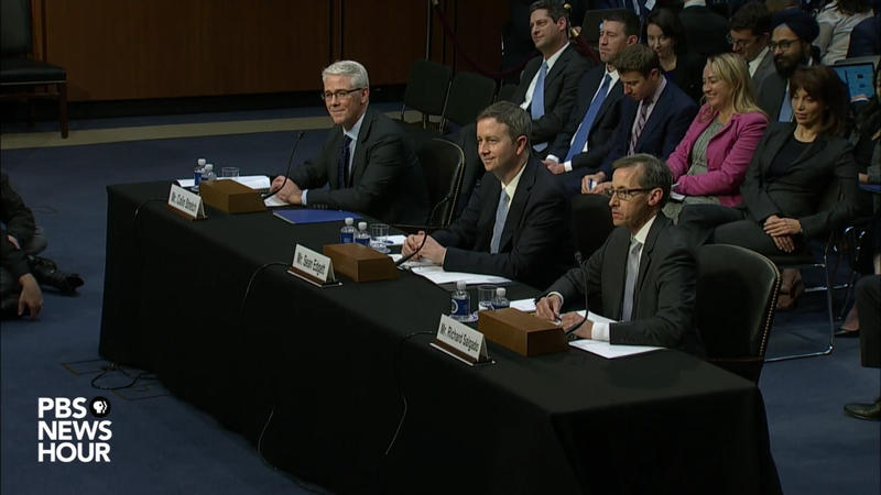 Facebook General Counsel Colin Stretch, Twitter Acting General Counsel Sean Edgett and Richard Salgado, who oversees law enforcement and national security issues for Google, during a lighter moment during a Senate Judiciary committee hearing on Oct. 31.