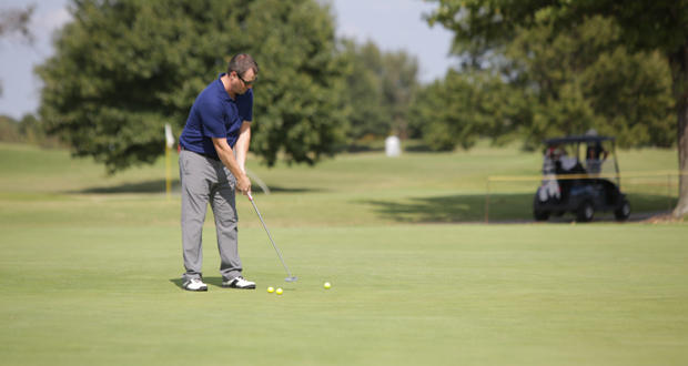 A man practices his putting at Lincoln Park Golf Course in Oklahoma City.
