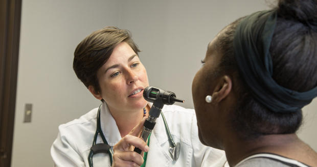 Nurse practitioner Rachel Mack examines a patient at Family Health Care & Minor Emergency Clinic in Warr Acres.