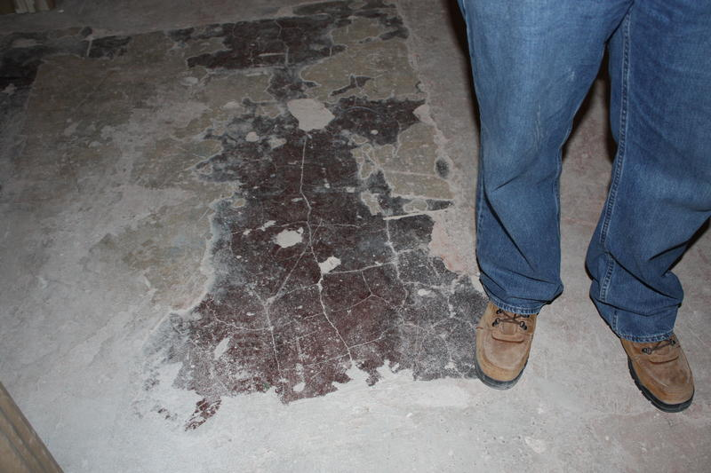 A glimpse of the building's original red-stained concrete.
