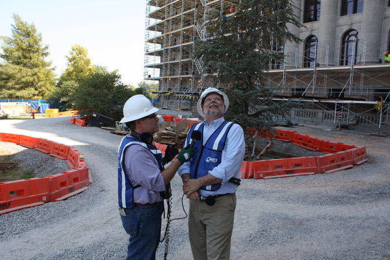 KGOU's Dick Pryor and eCapitol's Shawn Ashley outside the building.