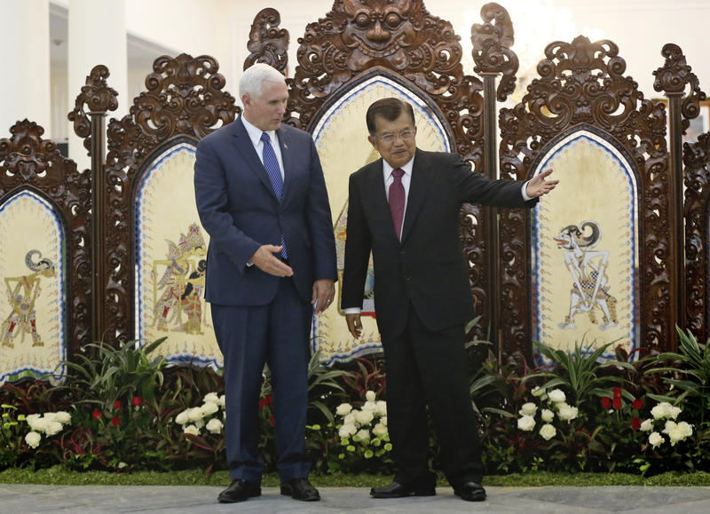 U.S. Vice President Mike Pence, left, is greeted by his Indonesian counterpart Jusuf Kalla during their meeting in Jakarta, Indonesia, Thursday, April 20, 2017.