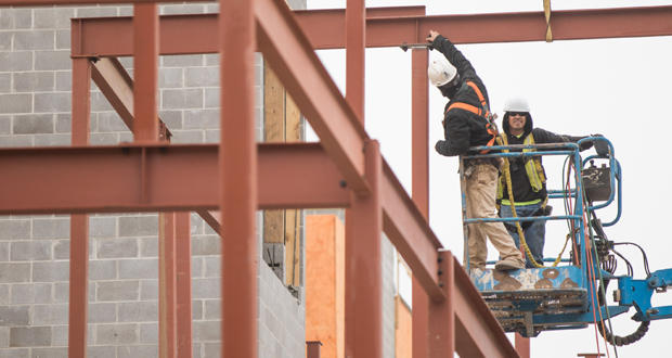 Workers at the construction site of West Village Apartments at Main Street and Fred Jones Avenue in Oklahoma City.