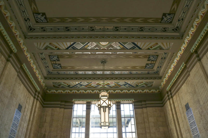 Very few of the original light fixtures remain, but the elaborate ceiling designs required little restoration.