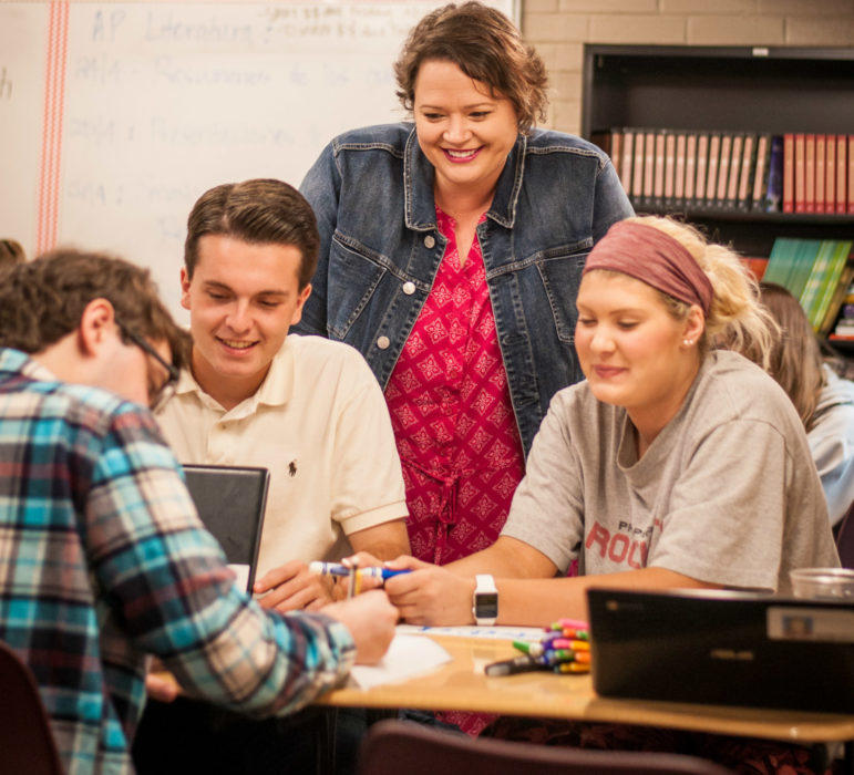 Shala Marshall, the 2016-17 Jenks Public Schools Teacher of the Year and a finalist for Oklahoma Teacher of the Year, assists her students in AP Spanish class. Fewer Oklahoma schools offer world language classes, and most that offer advanced classes are l