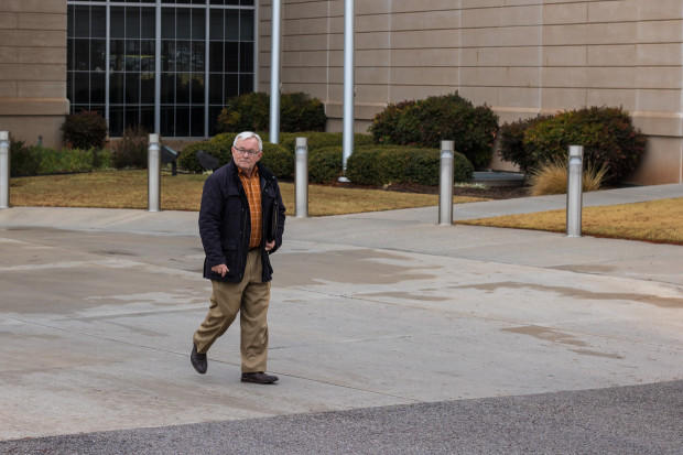Mickey Thompson, founder and director of Restore Oklahoma Now, leaves the attorney general's office after filing paperwork for State Question 795.