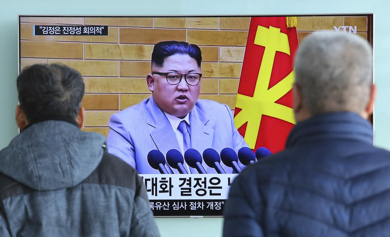 People watch a TV screen showing North Korean leader Kim Jong Un's New Year's speech, at Seoul Railway Station in Seoul, South Korea, Wednesday, Jan. 3, 2018.