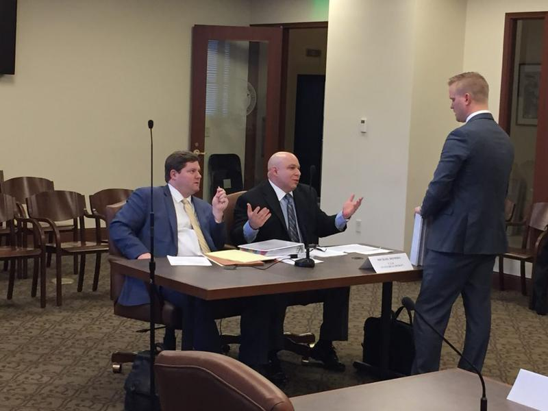 Mike Romero, middle, prepares to testify before the House committee investigating the state Health Department. At the table is Romero's lawyer, Peter Scimeca. Standing is committee chair Rep. Josh Cockroft.