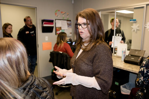 Janet Cizek, CEO of the Center for Therapeutic Interventions in Tulsa, speaks to an employee.