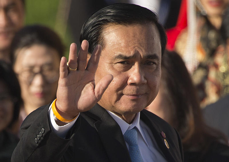 In this July 16, 2016, file photo, Thailand's Prime Minister Prayuth Chan-ocha waves as he arrives for a group photo of leaders at the 11th Asia-Europe Meeting (ASEM) in Ulaanbaatar, Mongolia.