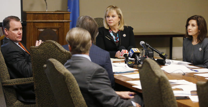 Oklahoma Gov.Mary Fallin, center, presides over a Board of Equalization meeting in Oklahoma City, Tuesday, Feb. 20, 2018. Lt. Gov. Todd Lamb is at left and Joy Hofmeister, Oklahoma's State Superintendent of Public Instruction is at right.