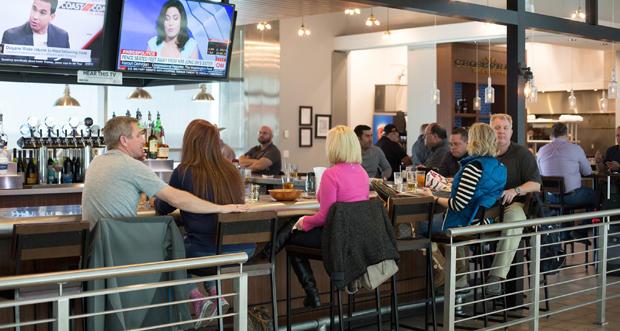 Travelers have drinks at a bar inside Will Rogers World Airport in Oklahoma City.