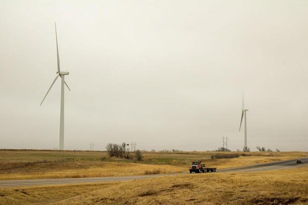 A line of wind turbines spin near Seiling, Okla.