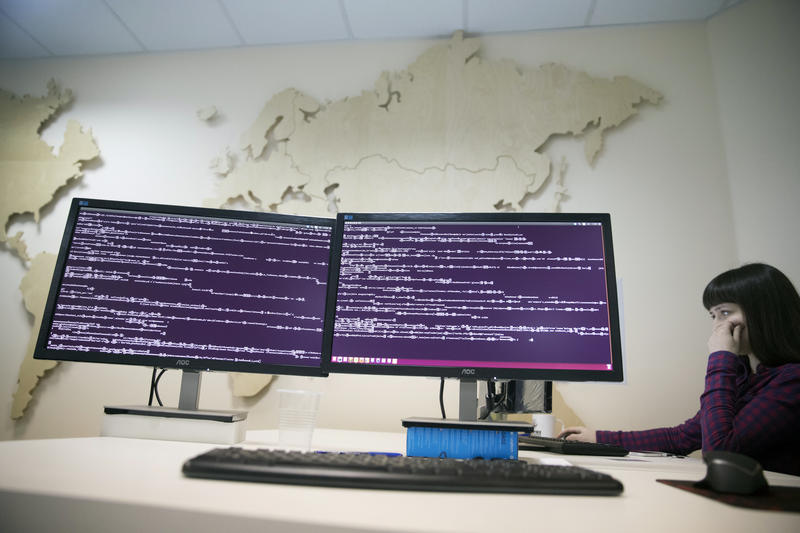 A computer code is seen on displays in the office of Global Cyber Security Company Group-IB in Moscow, Russia, Wednesday, Oct. 25, 2017. A new strain of malicious software has paralyzed computers at a Ukrainian airport, the Ukrainian capital's subway.