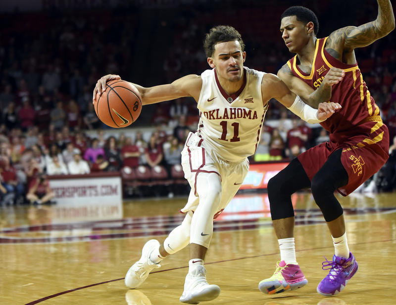 Oklahoma's Trae Young, left, drives past Iowa State's Donovan Jackson, right, in the second half of an NCAA college basketball game Friday, March 2, 2018, in Norman, Okla.
